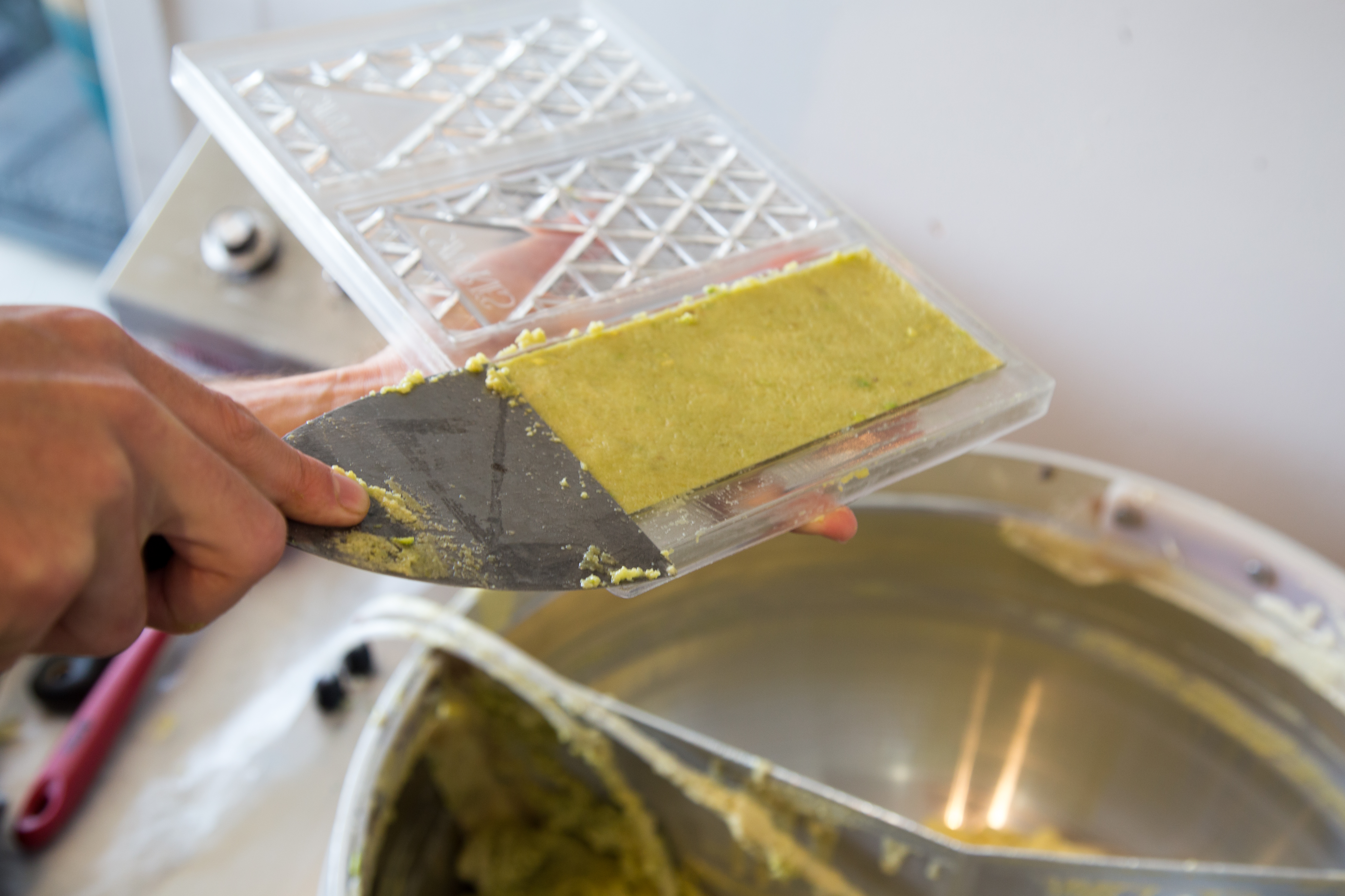The mixture is ladled into custom molds