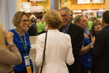 CAC President Tom Bellamore and Vice President Jan DeLyser greet PMA CEO Cathy Burns in the CAC booth.