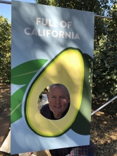 California avocado grower Randy Axell tries out one of CAC's photo booth props.