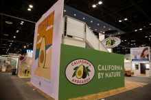 Signage on the CAC booth draws attention on the show floor and serves as photo backdrops (2016 booth photo).