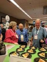 John Alstadt, Purchasing, Fuzzy's Taco Shop, prepares to sample the California Avocado and Shrimp Flatbread.