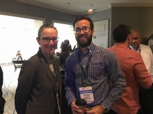 Susan Hughes and Brandon Campbell (Global Media Group for Black Angus Steakhouse) spoke during a break at the MEG conference.
