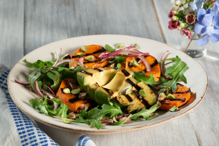The Commission's Living Well Brand Advocate showcases grilled avocados, a hot trend, with sweet potato in a tasty salad loaded with nutrition.