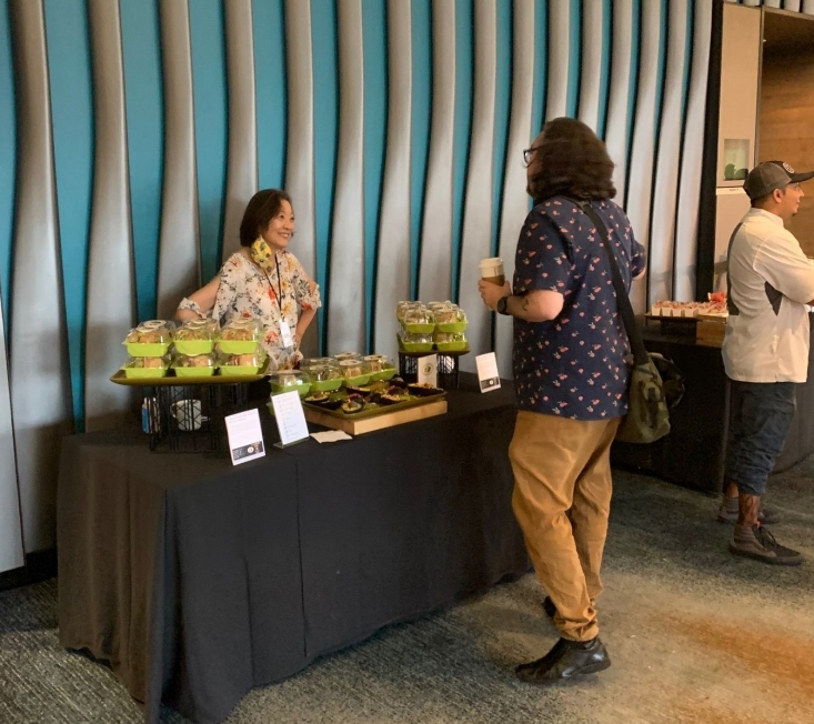 Discussing California avocado menu ideas with a Flavor Experience conference attendee.