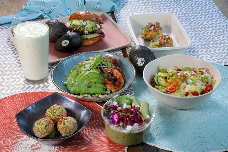 Some of the vendors' featured California Avocado Month dishes at Grand Central Market.