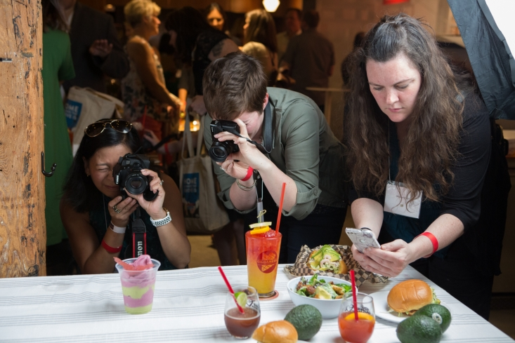 Media influencers snap press photos of Pine Street Market's California Avocado Month specials in advance of sharing the experience with their fans.