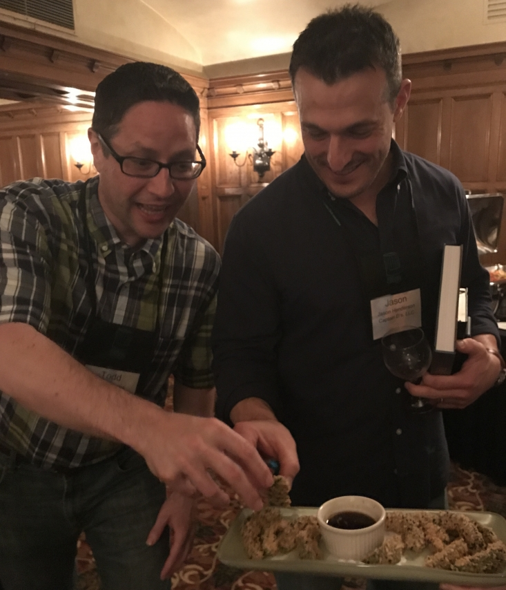Todd Huppert (L) and Jason Henderson of Captain D's eagerly reach for Deep Fried California Avocados.