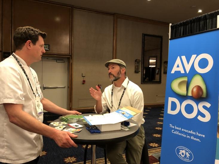 CAC foodservice team member Alexei Rudolf (right) discussing the California avocado season with Jason Tingley of UCLA.