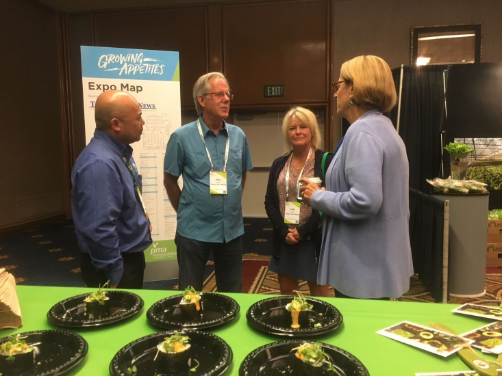 John Allstadt, Fuzzy's Taco Shop Director of Purchasing, discussed the California avocado crop with Jan DeLyser and Dave Cruz.