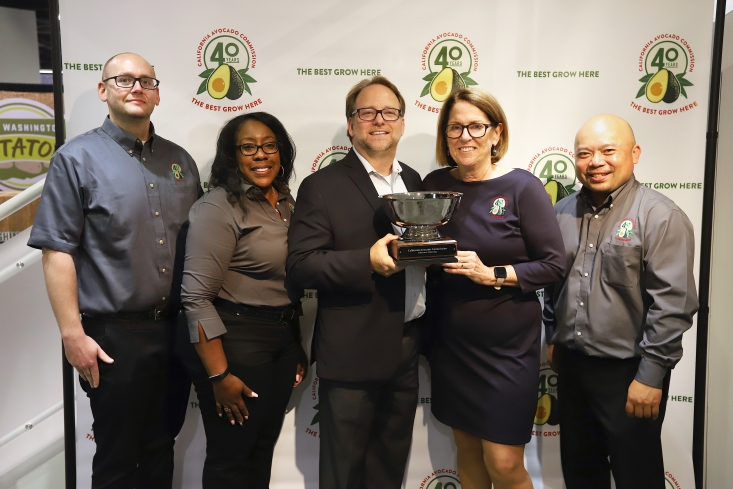 Ken Whitacre of Produce Business Magazine presents the Produce Business Marketing Excellence Award to the California Avocado Commission marketing team at PMA Fresh Summit.