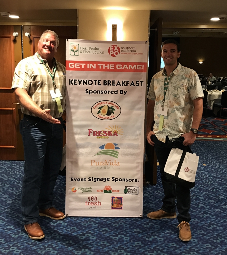California avocado growers Rick Shade (CAC board chairman) and his son C.J. Shade next to the CAC sponsorship sign at the breakfast.